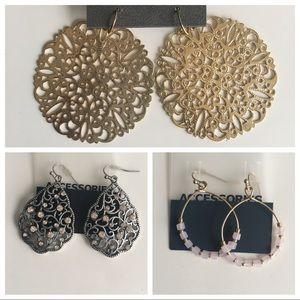 3 pairs of drop earrings.